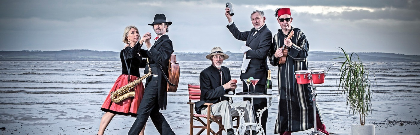 Behind the Scenes Band Portrait with 'Cafe Largo' on a Wet Scottish Beach in Winter, by Photographer Kim Ayres