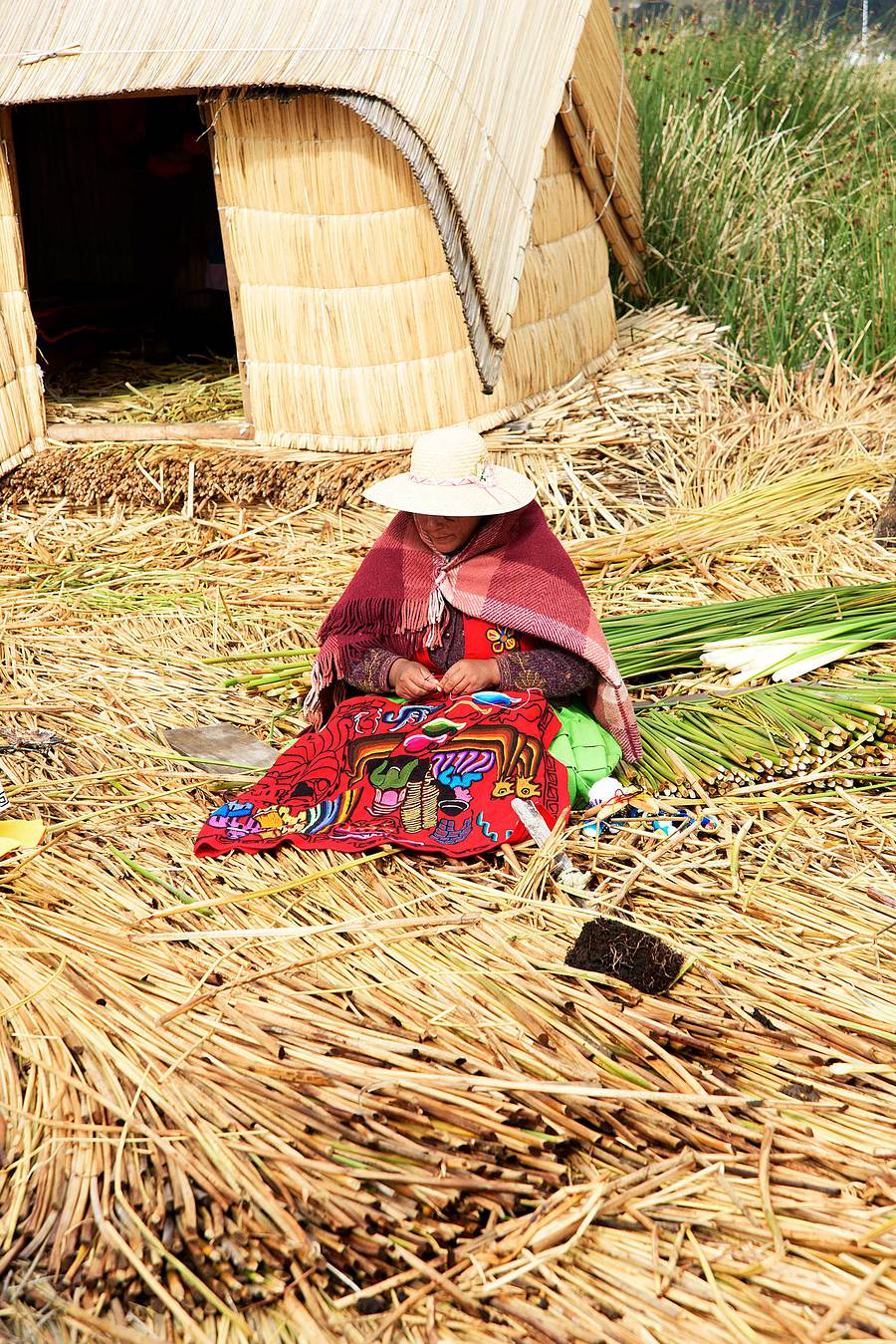 Traditionally dressed woman, floating island, Lake Titicaca, Peru / Photography by Jerome Razoir / Uploaded 5th June 2015 @ 04:09 PM