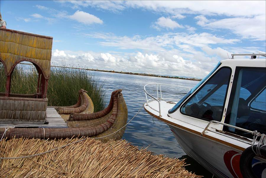 Reed boat with modern boat, Lake Titicaca. / Photography by Jerome Razoir / Uploaded 5th June 2015 @ 04:22 PM