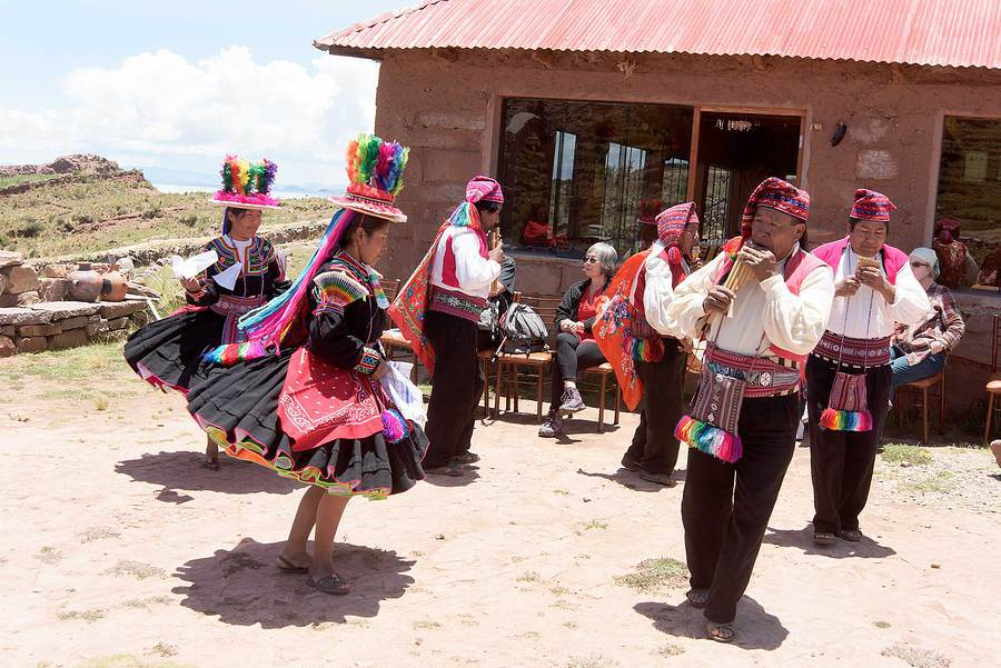 Traditional dancers, island on Lake Titicaca. / Photography by Jerome Razoir / Uploaded 5th June 2015 @ 04:29 PM