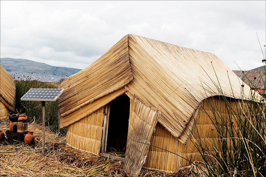 TRaditional reed hut on floating island on Lake Titicaca / Photography by Jerome Razoir / Uploaded 5th June 2015 @ 04:19 PM