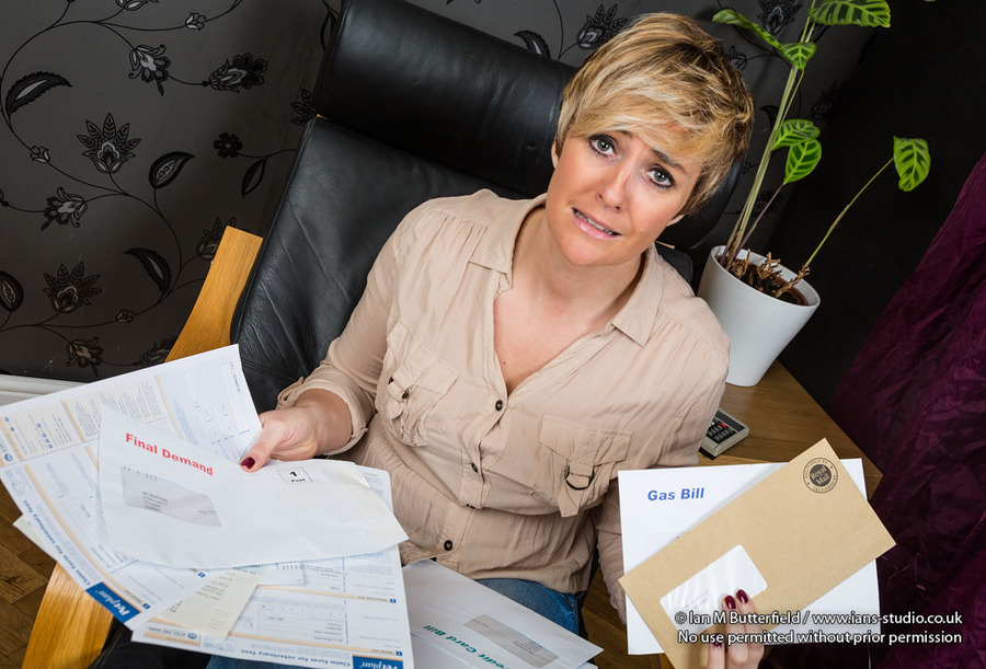 A worried woman with her bills / Photography by Ian M Butterfield, Taken at Ian's Studio / Uploaded 2nd May 2016 @ 04:55 PM