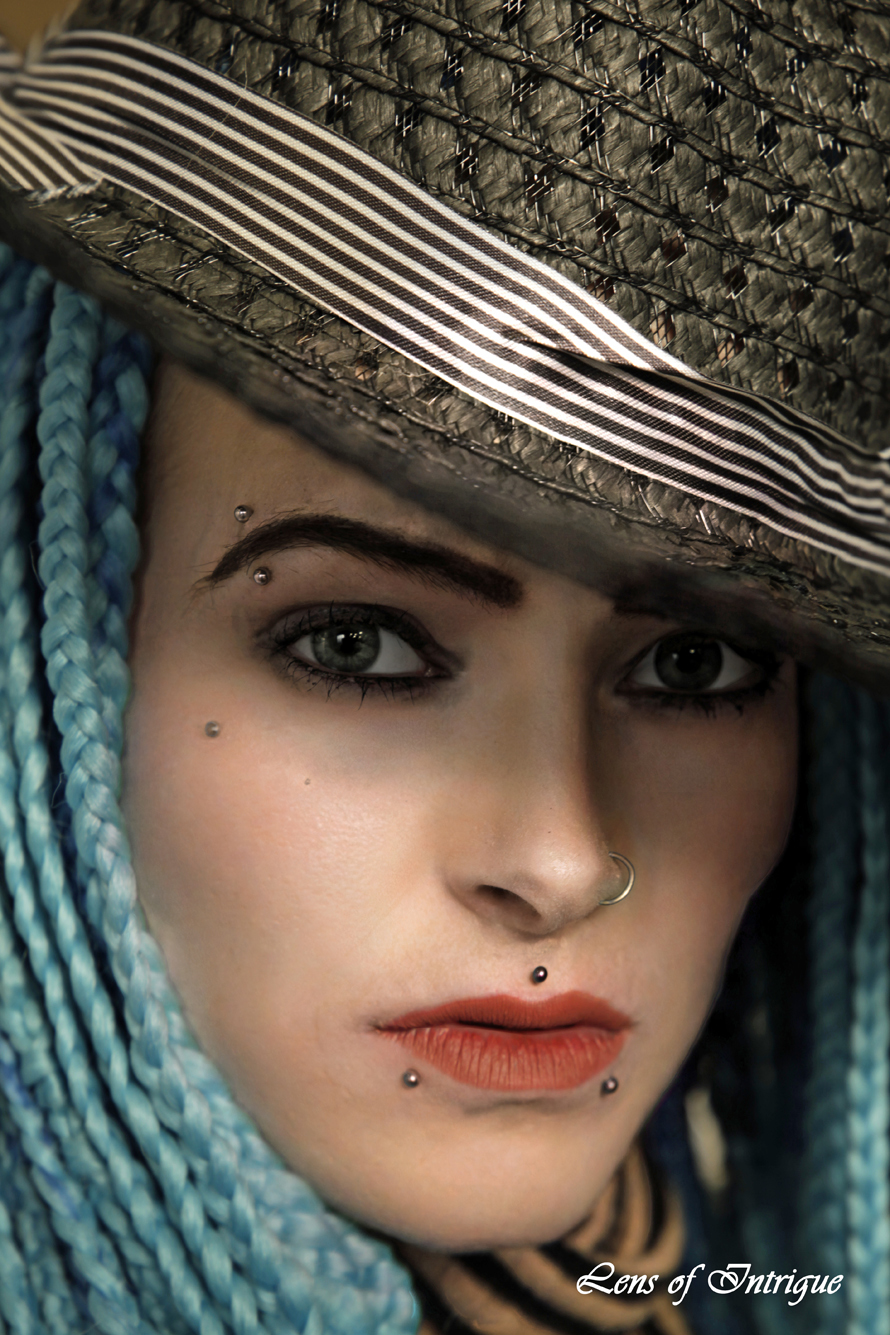 Although shrowded by her soft braided hair and shadowed by her hat, the sound of her eyes cannot be silenced!! / Photography by Tel Wales, Model SammyJane, Makeup by SammyJane, Post processing by Tel Wales, Taken at Tel Wales, Hair styling by SammyJane, Designer Tel Wales / Uploaded 6th January 2019 @ 08:52 PM